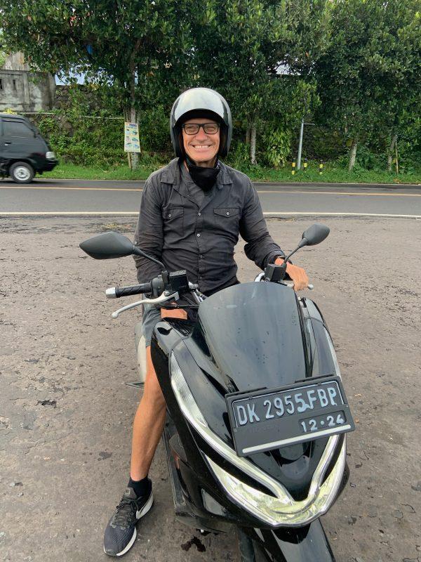 Taking a break from riding the motorbike in Bali.