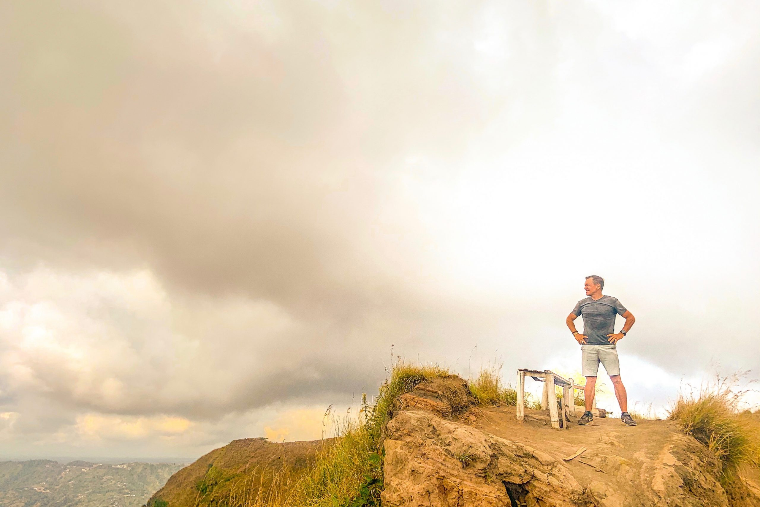 standing on top of the mountain